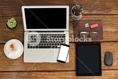 Laptop, smartphone and digital tablet with cup of coffee