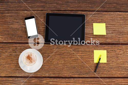 Digital tablet, smartphone and adhesive notes with a cup of coffee
