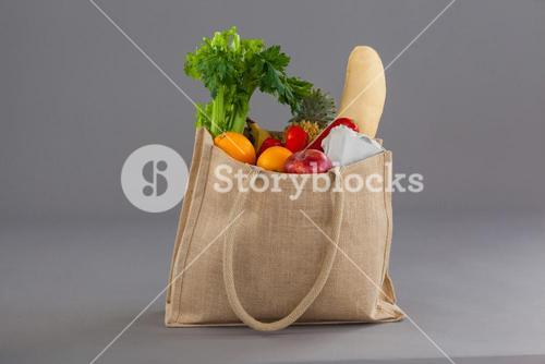 Vegetables and fruits in grocery bag