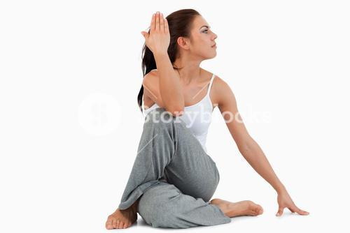 Portrait of a fit woman in the Ardha Matsyendrasana position