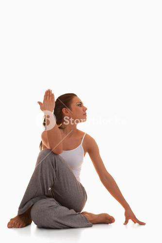 Portrait of a young woman in the Ardha Matsyendrasana position