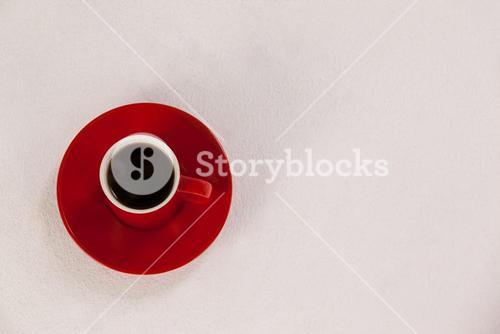 Red coffee cup on saucer