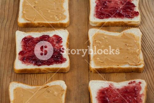 Peanut butter and jam on bread slices