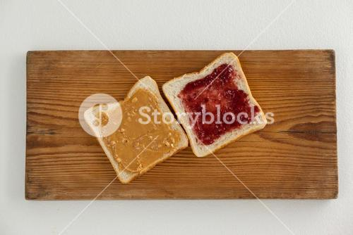 Bread slices with jam and peanut butter