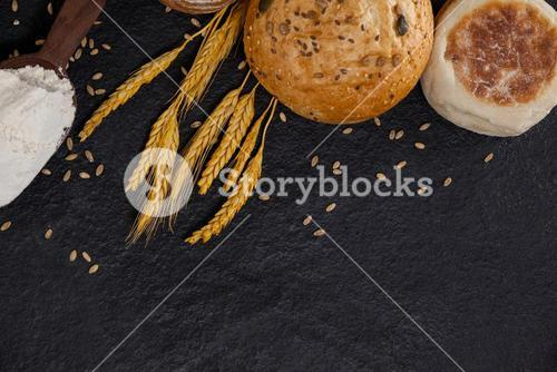 Bread loaves with flour and wheat grains
