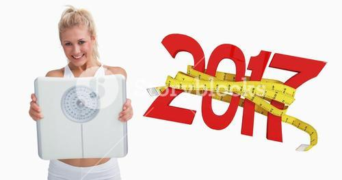 Composite image of portrait of young happy woman holding out weighing scales