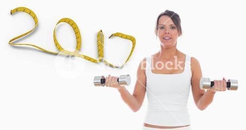 Composite image of portrait of young woman exercising with dumbbells