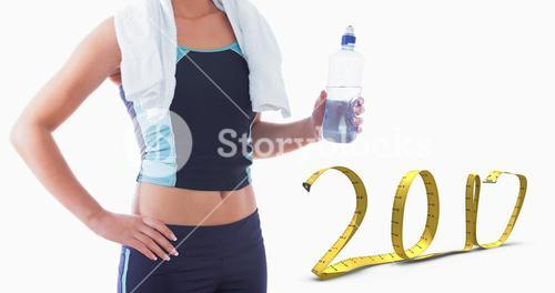 Composite image of midsection of sporty woman with towel around neck and water bottle