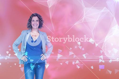 Composite image of businesswoman looking at camera with hands on hip