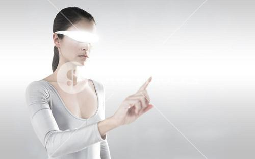 Composite image of woman pointing while using virtual video glasses