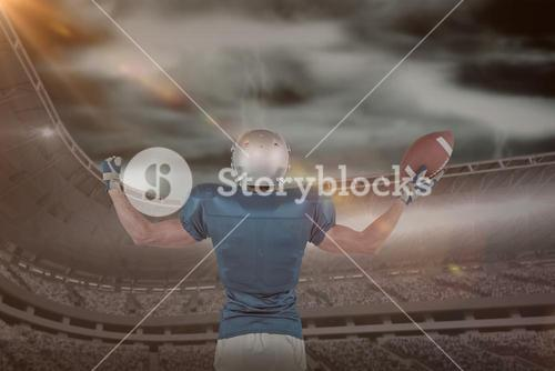 Composite image of rear view of american football player holding ball