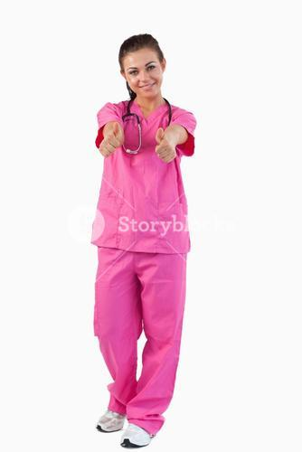 Portrait of a brunette doctor with thumbs up