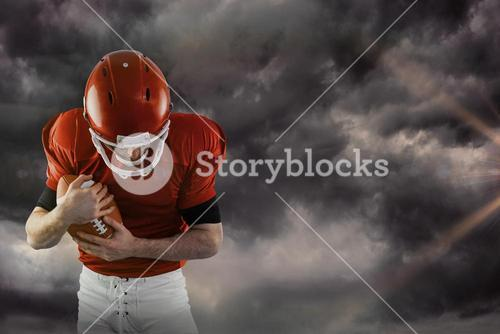 Composite image of american football player protecting football