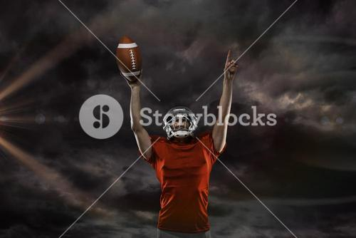 Composite image of american football player with holding ball arms raised