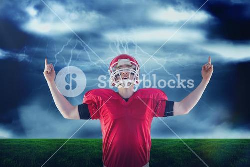 Composite image of american football player triumphing