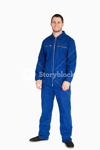 Smiling young mechanic in boiler suit