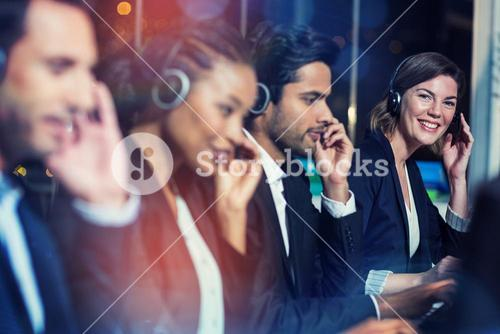 Business colleagues with headsets at office