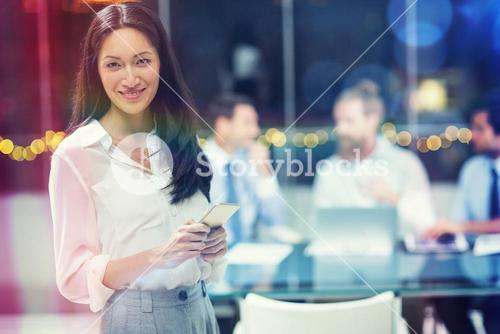 Businesswoman holding mobile phone