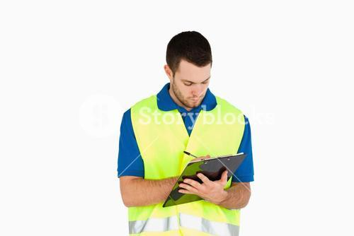 Young delivery man filling in bill of delivery