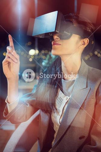 Female businesswoman using virtual reality headset
