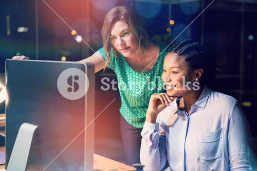 Women looking at computer