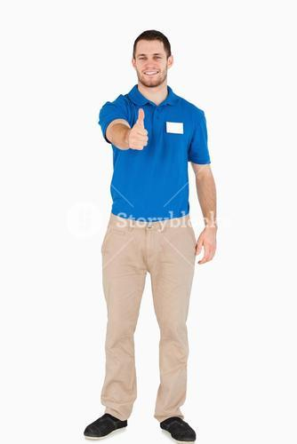 Smiling young salesman giving thumb up