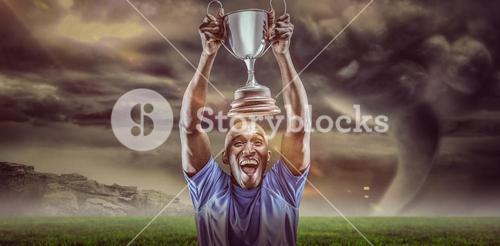 Composite image 3D of happy athlete cheering while holding trophy