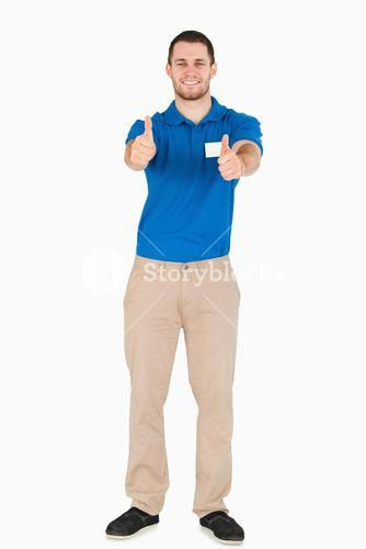 Smiling young salesman giving thumbs up