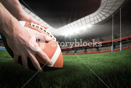 Composite image 3D of close up view of american football player preparing for a drop kick