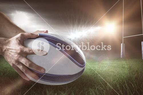 Composite image of close-up of of sports player holding ball 3D