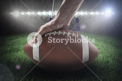 Composite image of american football player holding ball 3D
