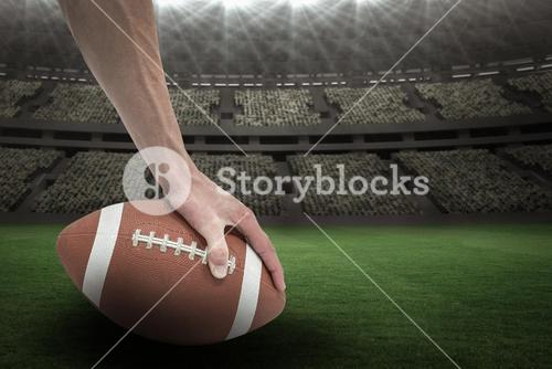 Composite image 3D of american football player placing the ball