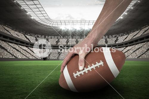 Composite image 3D of cropped image of american football player placing the ball