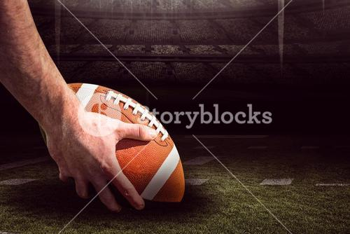 Composite image of american football player preparing for a drop kick 3D