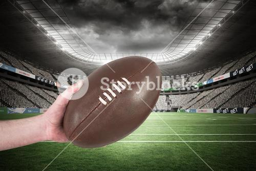 Composite image of rugby player handing a rugby ball 3D