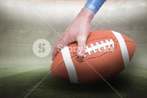 Composite image of american football player placing the ball 3D