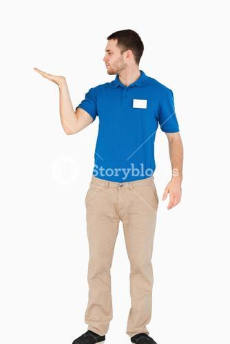 Young salesman presenting in his palm