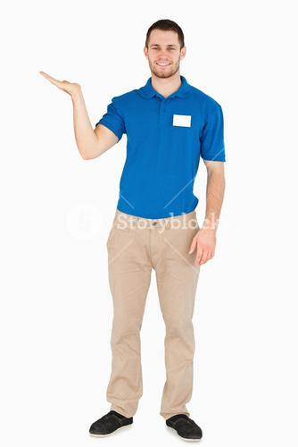 Smiling young salesman presenting in his palm