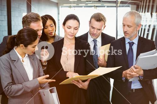 Lawyer looking at documents and interacting with business people