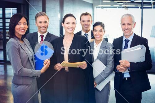 Portrait of lawyer standing together with business people