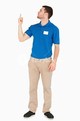Young salesman looking and pointing upwards