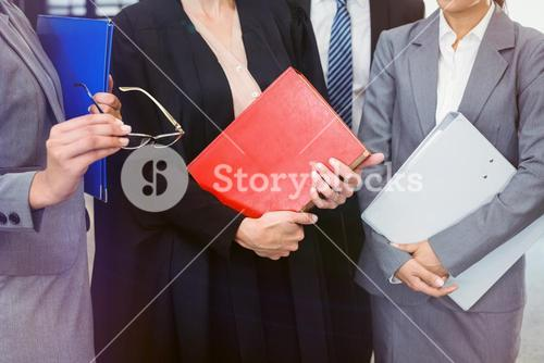 Midsection of lawyer holding law book