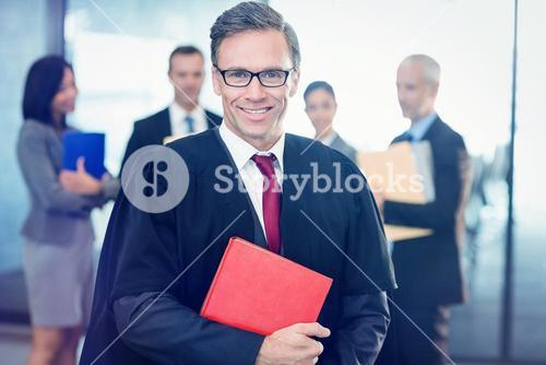 Portrait of lawyer holding law book