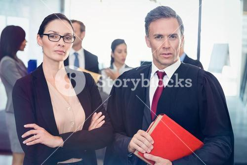 Portrait of businesswoman standing with lawyer