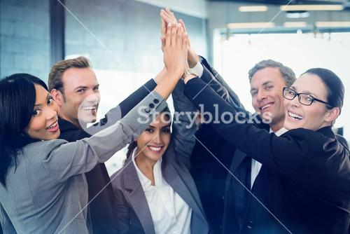 Portrait of businesspeople hands stacked over each other