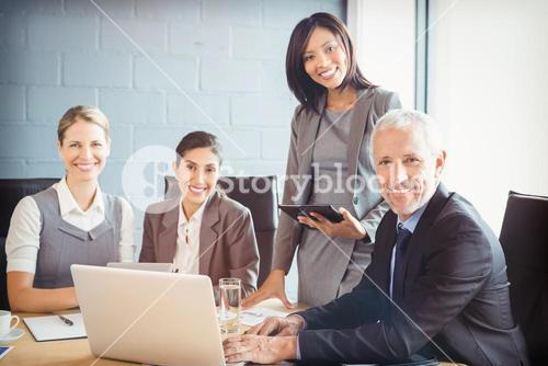 Portrait of business people at meeting in conference room