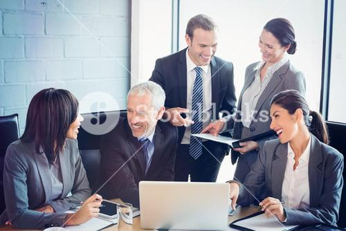 Businesspeople interacting in conference room