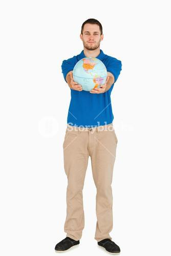 Young salesman presenting globe with his hands