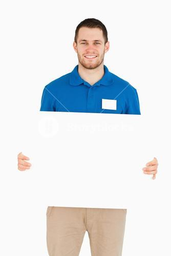 Smiling young salesman holding banner