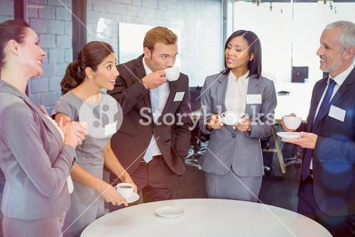 Businesspeople having a discussion during breaktime